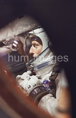 (21 Aug. 1965) --- View of astronaut Charles Conrad Jr. through the window as he sits in the Gemini-5 spacecraft during prefl...