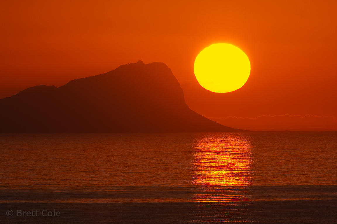 Sunrise over the Atlantic Ocean from Miller's Point, showing the disc of the sun, Cape Peninsula, South Africa