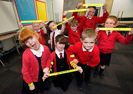 Balmalloch Primary, Kilsyth..25.10.13.Kids from the school display the Taylor Wimpey wrist slaps which will increase their vi...