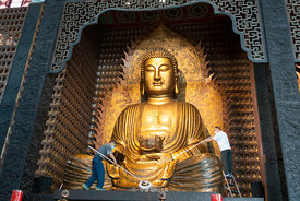 A statue of Buddha being cleaned at the Fo Guang Shan Buddha Museum in Dashu District, Kaohsiung, Taiwan