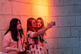 Tourists taking selfies inside Sagrada Família, a church built by the renowned architect Antoni Gaudí in Barcelona, Spain.