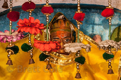 Goddess Ganga idol in a temple on the Ganges River, Varanasi, India. Here she is still covered from the nights' sleep, she's ...