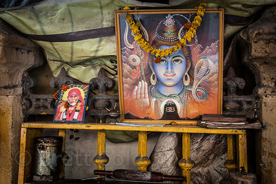 Images of Shiva and Sai Baba in a shop in Sovabazar, Kolkata, India.