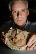 Andrew Parker with trilobite fossil