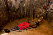 Elmolo man sleeping in his hut, Ngomongo Village, Kenya