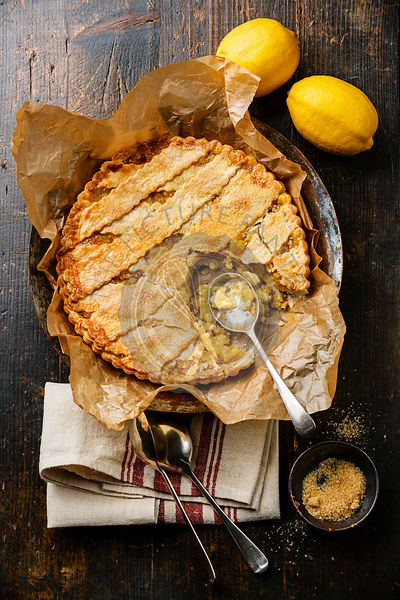Homemade Lemon Pie and spoon on wooden background