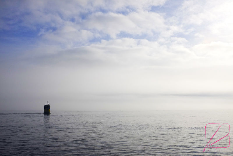 Perroc'h's north cardinale light buoy daymark in front of mist