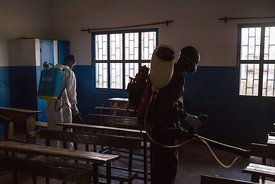 Officers from Ministry of Health spread pesticide against carriers of plague such as fleas in a primary school at Andraisoro,...