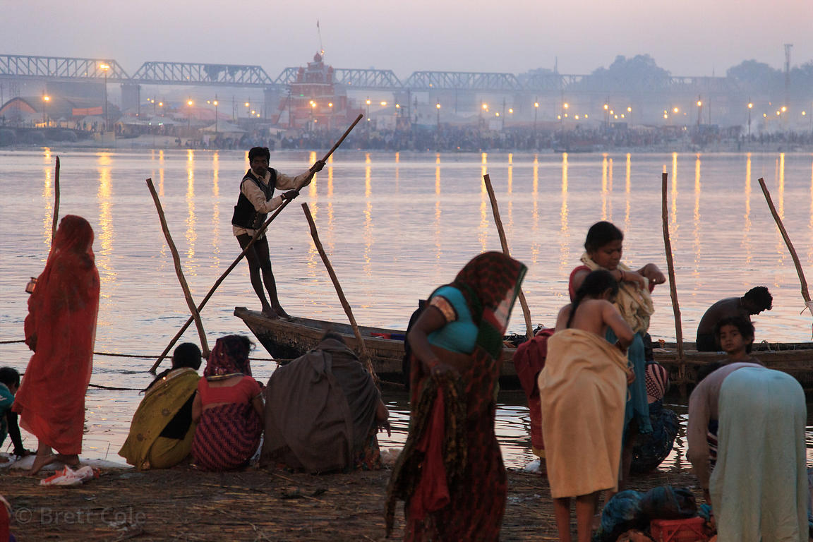 A boatman travels on the Ganges River at night, at the 2013 Kumbh Mela, Allahabad, India.