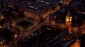 Aerial footage over the Houses of Parliament at night, Westminster, London, UK