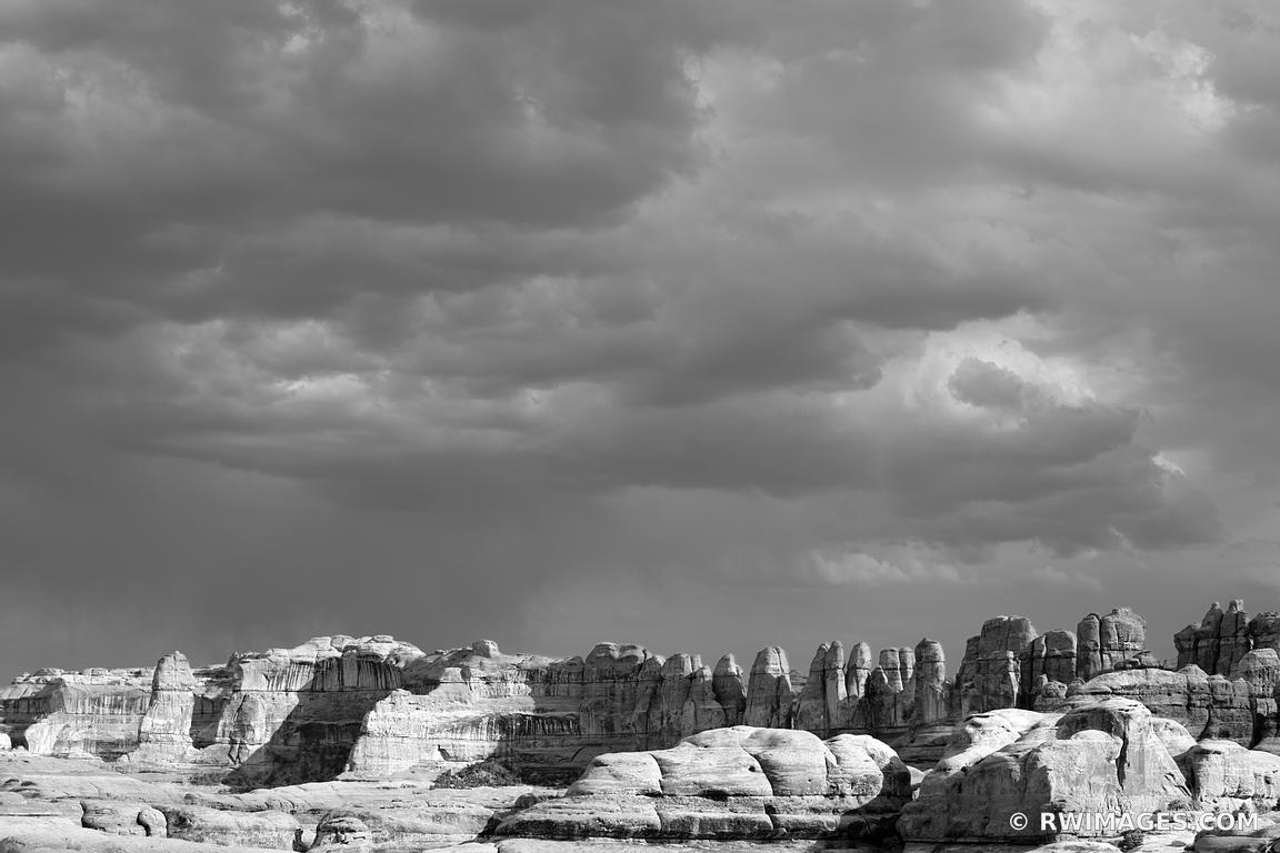 CHESLER PARK TRAIL NEEDLES DISTRICT STORMY SKIES CANYONLANDS NATIONAL PARK UTAH BLACK AND WHITE