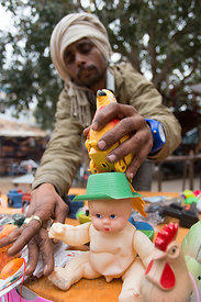 Toy seller at a market, Pushkar, Rajasthan, India