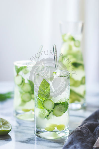Green sangria with melon, cucumber, basil, mint, grapes and lime drink.