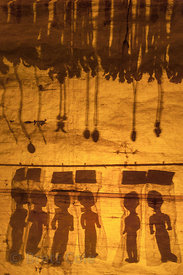 Silhouetted dolls are illuminated by a nightlight in a market stall that has closed for the night, at the 2013 Kumbh Mela, Al...