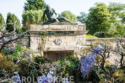 Statue of slave or gladiator above door to walled garden. Iford Manor, Bradford-on-Avon, Wiltshire