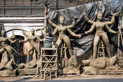 A man sculpts large clay Hindu religious idols in Mali Panchghara, Howrah, India. The idols are made from river mud packed on...