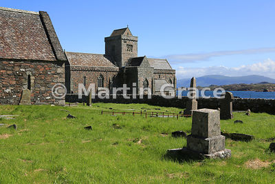 Oran's Burial Ground (Reilig Odhrain) with Oran's Chapel (left) and Iona Abbey beyond, Iona, Inner Hebrides, Scotland