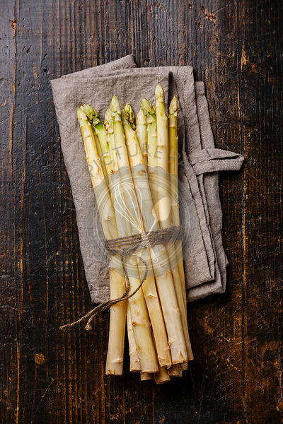 Fresh raw White asparagus on wooden background