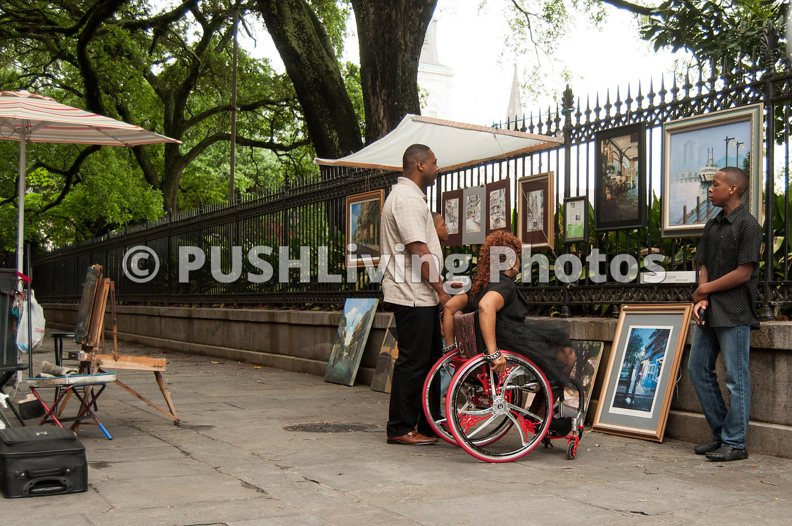 Mother using a wheelchair exploring the French Quarter of New Orleans with her family