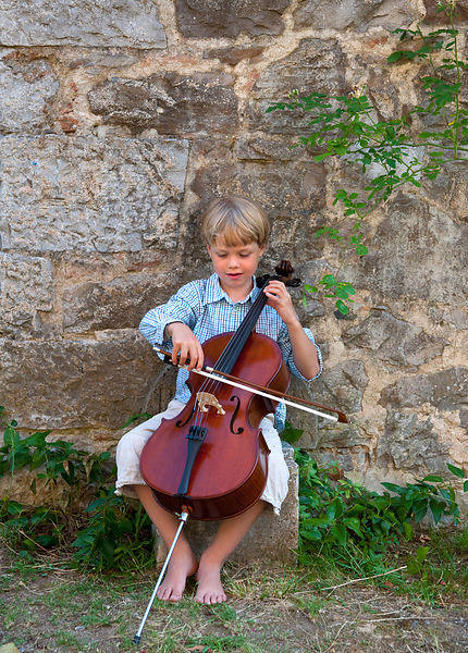 Boy playing cello outdoors