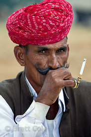 Farmer smoking, Pushkar, Rajasthan, India