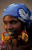 Peul (or Fula) woman with characteristic mouth tattoo wearing traditional golden earrings, Djenné, Mali