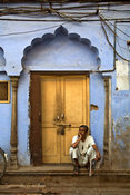 India - Delhi - A man lounges inside the remains of the Sultan Singh Ghar ki Haveli