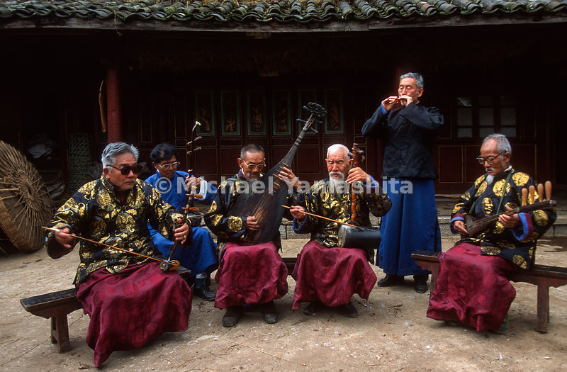 Naxi traditional band music has died out through out China and is now played for tourists. They perform nightly in town to en...