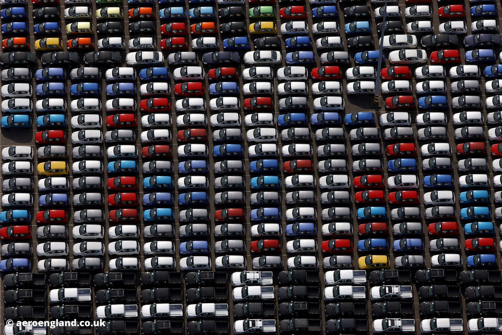 Vertical aerial photograph of cars lined up on decks for export / import