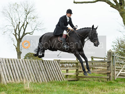 William Bell jumping a hunt jump near Peake's. The Cottesmore Hunt at Somerby