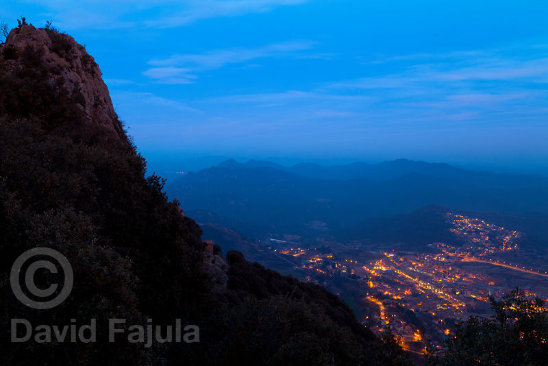 Sanctuary of Queralt (Santuari de Santa Maria de Queralt) at dusk, with Berga at the bottom