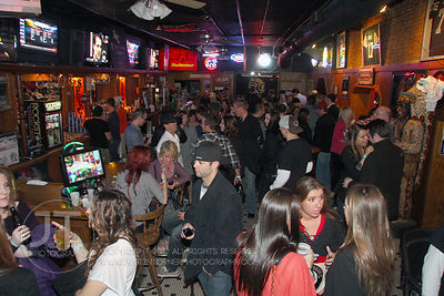 Patrons fill the bar at the Sports Column, 12 S. Dubuque Street, in downtown Iowa City Saturday night. Copyright Justin Torne...