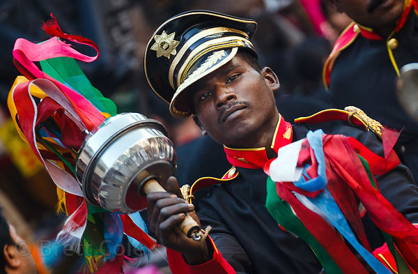 Bandmember in a parade in the Paharganj neighborhood of Delhi, India.