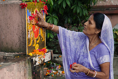 A woman makes an offering to Kushmanda, one of the nine Nava-Durgas (forms of the Goddess Durga) during the Durga Puja festiv...