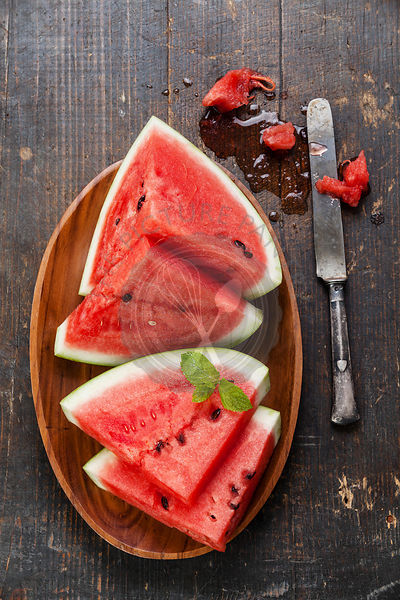 Watermelon slices on wooden background