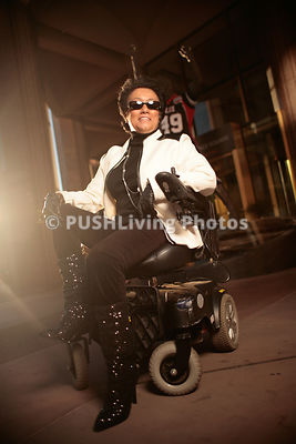 Woman in a wheelchair in Glendale in the lead up to Super Bowl 49