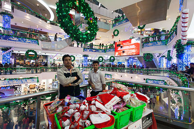 Workers sell Santa hats in South City Mall, Kolkata, India. South City is the largest mall in East India. Christmas is celebr...