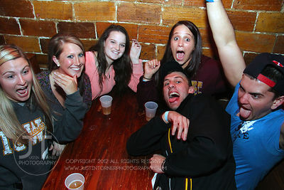 Patrons pose for the camera at the Sports Column, 12 S. Dubuque Street, in downtown Iowa City Saturday night. Copyright Justi...
