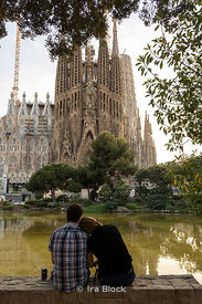 Tourists near Sagrada Família, a church built by the renowned architect Antoni Gaudí in Barcelona, Spain.