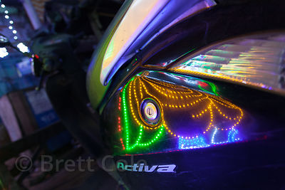LED lights reflect in a car's surface during Kali Puja in Kalighat, Kolkata, India.