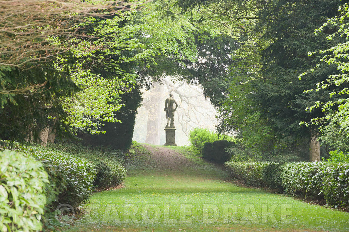 Statue of Apollo framed by trees at the end of the Long Walk, part of Charles Bridgeman's original garden scheme. Rousham Hou...