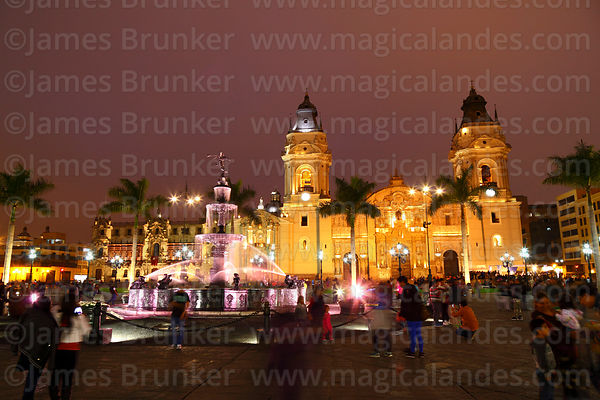 Cathedral and families enjoying and evening out in Plaza de Armas, Lima, Peru