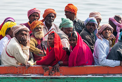 Pilgrims go for a boat ride on the Ganges River, Varanasi, India.