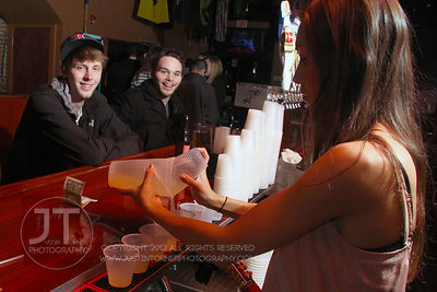 Bartender Gen Coulson attends to bar patrons the Airliner Bar, 22 S Clinton Street in downtown Iowa City Saturday night. Copy...