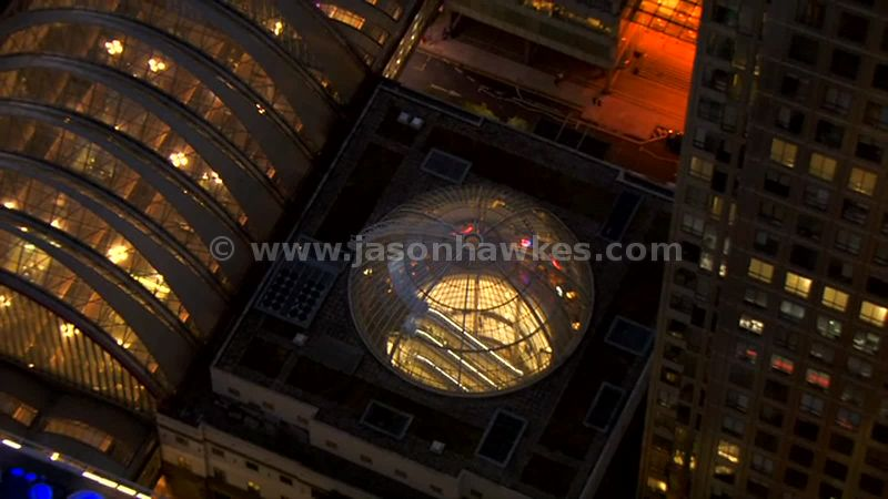 Aerial footage of Canary Wharf Shopping Centre at night, London