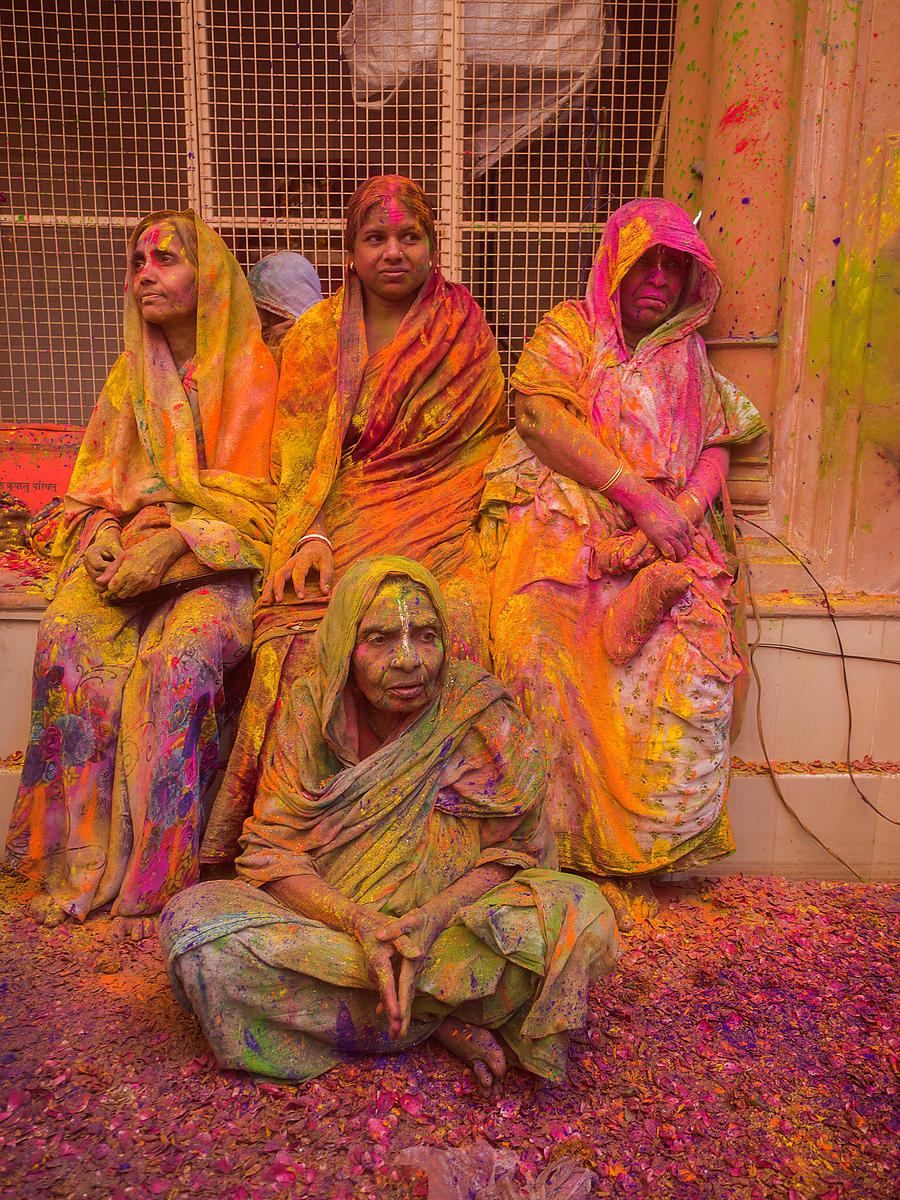 Widows rest during the holi celebration at the Gopinath temple in Vrindavan.