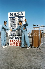 16 Nov. 1966 - Gemini-12 astronauts James A. Lovell Jr. (left), and Edwin E. Aldrin Jr., pilot, shake hands in front of the N...