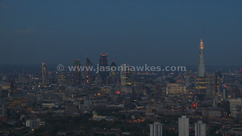Aerial footage of the City of London skyscrapers and The Shard at night