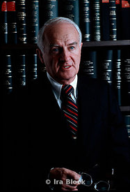 Portrait of a corporate executive in front of law books