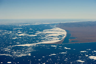 Aerial view of  Wrangel Island coastline with pack ice, Far Eastern Russia, August 2010.